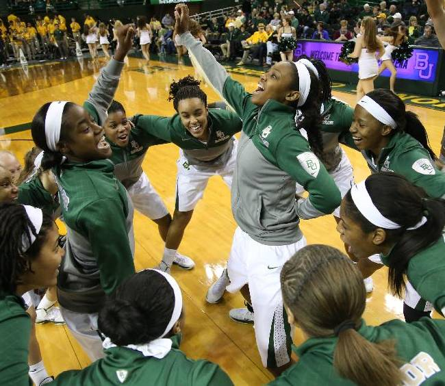 Baylor players gather at mid court before their NCAA women's college basketball game against Kansas, Sunday, Jan. 5, 2014, in Waco, Texas. (Baylor won 75-55