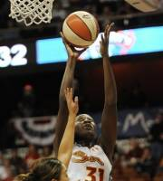 Connecticut Sun's Tina Charles (31) goes up for a basket while guarded by New York Liberty's Leilani Mitchell during the first half of Game 1 of an opening-round WNBA basketball playoff series in Uncasville, Conn., Thursday, Sept. 27, 2012. (AP Photo/Jessica Hill)