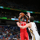 NEW ORLEANS, LA - OCTOBER 14: Trevor Ariza #1 of the Houston Rockets shoots against Omer Asik #3 of the New Orleans Pelicans at the Smoothie King Center on October 14, 2014 in New Orleans, Louisiana. (Photo by Layne Murdoch Jr./NBAE via Getty Images)