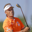 Bernhard Langer follows his ballThursday, July 11, 2013, in the first round of the U.S. Senior Open golf tournament in Omaha, Neb. (AP Photo/Nati Harnik)