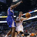 Phoenix Suns' Goran Dragic, of Slovenia, right, passes around Los Angeles Clippers' DeAndre Jordan during the second half of an NBA basketball game, Tuesday, March 4, 2014, in Phoenix The Associated Press