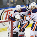 Edmonton Oilers' Boyd Gordon (27) celebrates his game-winning goal over Buffalo Sabres goaltender Michal Neuvirth as Teddy Purcell (16) and Matt Hendricks (23) join in during the third period of an NHL hockey game Friday, Nov. 7, 2014, in Buffalo, N.Y. Th
