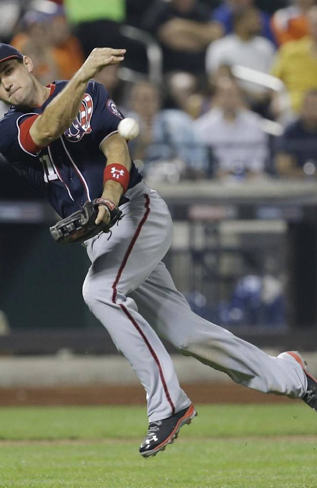 Washington Nationals third baseman Ryan Zimmerman throws out New York Mets' Travis d'Arnaud during the fifth inning of a baseball game on Wednesday, Sept. 11, 2013, in New York