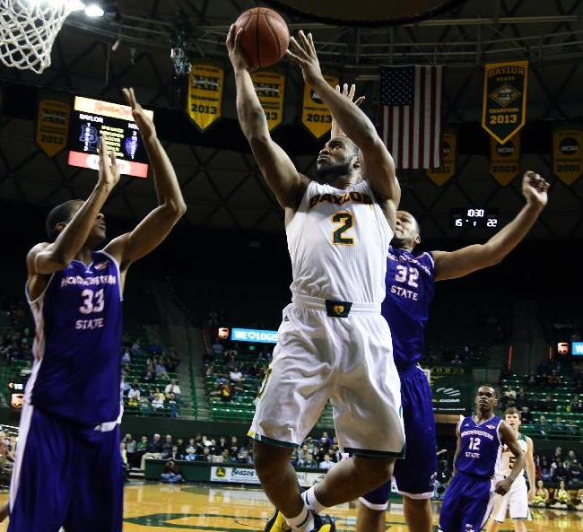 Baylor forward Rico Gathers (2), center, scores over Northwestern State forwards Ryan King (33) and DeQuan Hicks (32) during the first half of an NCAA college basketball game, Wednesday, Dec. 18, 2013, in Waco, Texas