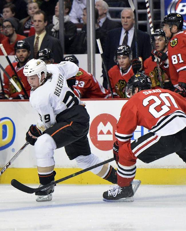 Anaheim Ducks left wing Matt Beleskey, left, looks to pass as Chicago Blackhawks left wing Brandon Saad defends during the first period of an NHL hockey game Friday, Dec. 6, 2013 in Chicago