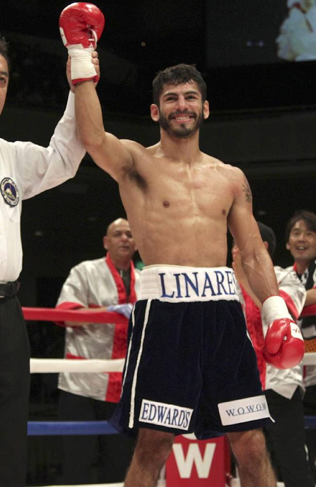 Venezuela's Jorge Linares is declared the winner by the referee after knocking out Dominican Republic's Francisco Contreras in the first round of their WBA lightweight scheduled 10-round bout in Tokyo, Sunday, Nov. 10, 2013. The card replaced Linares' originally scheduled title bout against Cuban champion Richard Abril who canceled because of injury