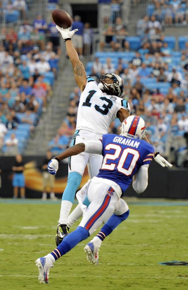 Carolina Panthers' Kelvin Benjamin (13) reaches in vain for a pass as Buffalo Bills' Corey Graham (20) defends during the first half of a preseason NFL football game in Charlotte, N.C., Friday, Aug. 8, 2014