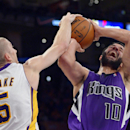 Los Angeles Lakers guard Steve Blake, left, blocks the shot of Sacramento Kings guard Greivis Vasquez, of Venezuela, during the second half of an NBA basketball game Sunday, Nov. 24, 2013, in Los Angeles The Associated Press