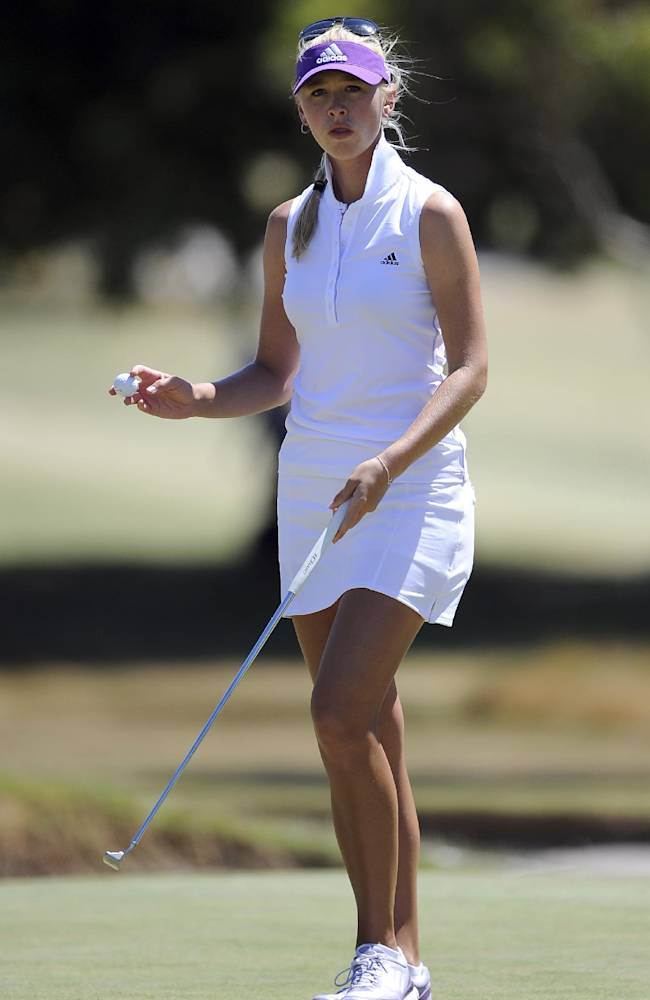 Jessica Korda of the United States reacts after putting on the ninth hole during the fourth round of the Australian Women's Golf Open at The Victoria Golf Club in Melbourne, Sunday, Feb. 16, 2014