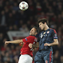 Manchester United's Ryan Giggs, left, and Bayern's Javier Martinez go for a header during the Champions League quarterfinal first leg soccer match between Manchester United and Bayern Munich at Old Trafford Stadium, Manchester, England, Tuesday, April 1,