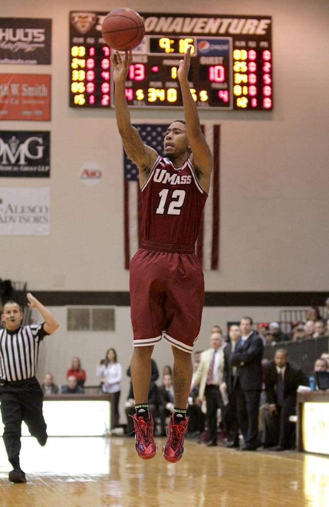 Massachusetts guard Trey Davis puts up a 3pointer to tie the NCAA college basketball game against St. Bonaventure during the first half in St. Bonaventure, N.Y., Wednesday, Jan. 29, 2014. (AP Photp/Nick LoVerde)