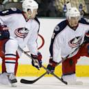 Columbes Blue Jackets defenseman Nikita Nikitin (6), of Russia, and right wing Corey Tropp (26) take a knee on the ics after play was stopped for a medical emergency in the first period of an NHL Hockey game against the Dallas Stars Monday, March 10, 2014, in Dallas. (AP Photo/Sharon Ellman)