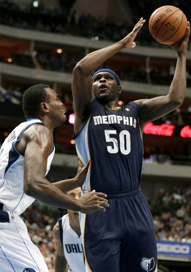 Memphis Grizzlies' Zach Randolph (50) goes up for a shot attempt over Dallas Mavericks' Samuel Dalembert of Haiti in the first half of an NBA basketball game Saturday, Nov. 2, 2013, in Dallas
