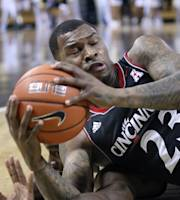 Central Florida guard Isaiah Sykes (3) wrestles for the ball with Cincinnati guard Sean Kilpatrick (23) during the first half of an NCAA basketball game, Wednesday, Feb. 19, 2014, in Orlando Fla. (AP Photo Reinhold Matay)