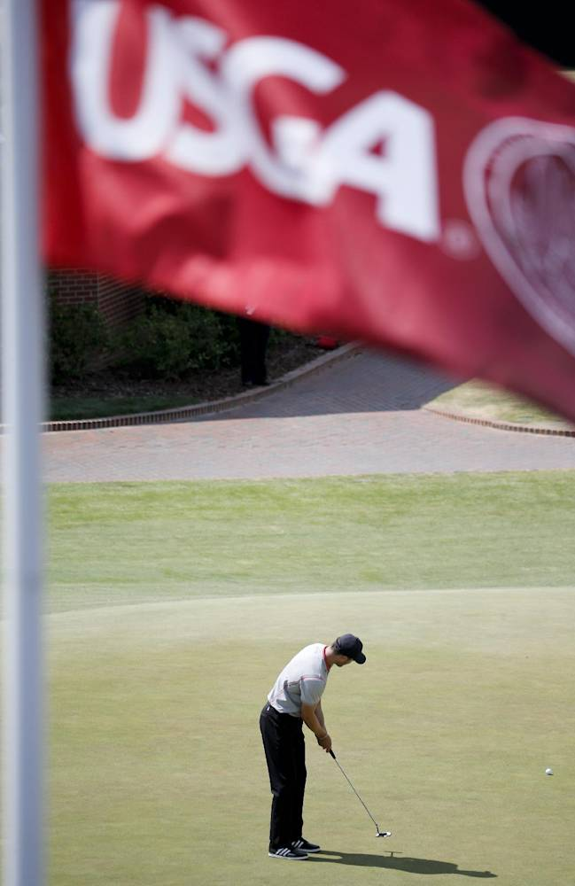 Martin Kaymer, of Germany, works on his putting on the practice green after a practice round for the U.S. Open golf tournament in Pinehurst, N.C., Tuesday, June 10, 2014. The tournament starts Thursday