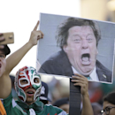 Mexico fans hold an image of head coach Miguel Herrera as they cheer before the first half of the CONCACAF Gold Cup championship soccer match between Mexico and Jamaica, Sunday, July 26, 2015, in Philadelphia. (AP Photo/Michael Perez)