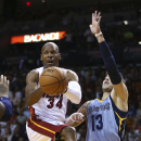 Miami Heat's Ray Allen (34) passes off against Memphis Grizzlies' Mike Miller (13) during the first half of an NBA basketball game in Miami, Friday, March 21, 2014 The Associated Press