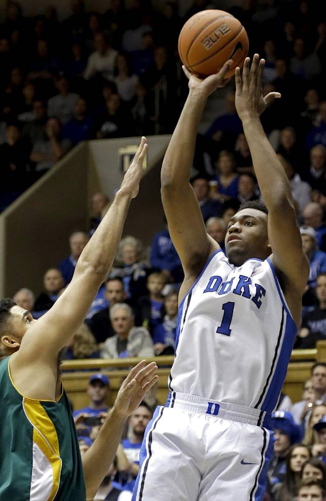 Duke's Jabari Parker (1) shoots as Vermont's Luke Apfeld defends during the first half of an NCAA college basketball game in Durham, N.C., Sunday, Nov. 24, 2013