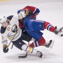 Buffalo Sabres left winger Tyler Ennis (63) and Montreal Canadiens defenseman Andrei Markov (79) collide during the third period of an NHL hockey game, Saturday Dec. 7, 2013 in Montreal The Associated Press