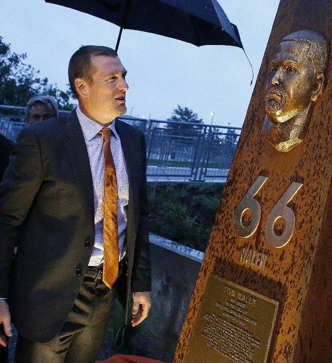Former Denver Broncos center Tom Nalen looks at a newly unveiled pillar bearing his likeness at the opening ceremony for the Broncos Ring of Fame Plaza, at Mile High Stadium in Denver, Friday Sept. 27, 2013. Nalen is to be inducted into the Ring of Fame this weekend