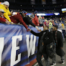 Former New England Patriots players Troy Brown, left, and Ty Law, right, greet fans before the NFL football AFC Championship game between the Patriots and Indianapolis Colts Sunday, Jan. 18, 2015, in Foxborough, Mass. Brown and Law were named as two of th