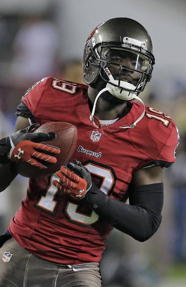 Tampa Bay Buccaneers wide receiver Mike Williams (19) catches a pass before an NFL football game against the Carolina Panthers Thursday, Oct. 24, 2013, in Tampa, Fla