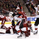 Ottawa Senators' Milan Michalek (9), of the Czech Republic, celebrates his goal against the Arizona Coyotes as teammate Alex Chiasson, right, celebrates while Coyotes' Connor Murphy (5) kneels on the ice during the first period of an NHL hockey game Satur