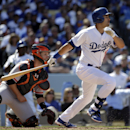 Los Angeles Dodgers' Andre Ethier, right, hits an RBI-single during the fifth inning of a baseball game against the San Francisco Giants, Friday, April 4, 2014, in Los Angeles The Associated Press