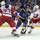 St. Louis Blues' Joakim Lindstrom (10) is tied up by Detroit Red Wings' Kyle Quincey (27) as St. Louis Blues' Paul Stastny (26) skates past Detroit Red Wings' Stephen Weiss (90) during an NHL hockey game, Thursday, Jan. 15, 2015, in St. Louis The Associat
