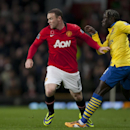 Manchester United s Wayne Rooney, left, keeps the ball from Arsenal s Bacary Sagna during their English Premier League soccer match at Old Trafford Stadium, Manchester, England, Saturday Nov. 10, 2013