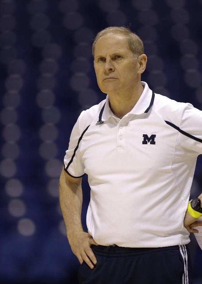 Michigan head coach John Beilein looks on during practice for their NCAA Midwest Regional semifinal college basketball tournament game Thursday, March 27, 2014, in Indianapolis. Michigan plays Tennessee on Friday, March 28, 2013