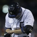 Detroit Tigers' Omar Infante looks at his hand after being hit by a pitch from San Francisco Giants' Santiago Casilla during the ninth inning of Game 4 of baseball's World Series Sunday, Oct. 28, 2012, in Detroit. (AP Photo/Matt Slocum)