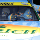 Driver Aric Almirola climbs into his car during a practice for the NASCAR Sprint Cup Series auto race at Chicagoland Speedway in Joliet, Ill., Friday, Sept. 12, 2014. (AP Photo/Nam Y. Huh)