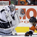 Los Angeles Kings' Jonathan Quick, left, blocks a shot by Philadelphia Flyers' Claude Giroux during the first period of an NHL hockey game, Monday, March 24, 2014, in Philadelphia The Associated Press