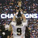 FILE - In this Feb. 7, 2010, file photo, New Orleans Saints quarterback Drew Brees (9) holds his son Baylen after the NFL Super Bowl XLIV football game against the Indianapolis Colts in Miami. Worries about Brees' torn labrum made some teams back away. That helped the Saints land the quarterback with a six-year, $60 million contract and an $8 million signing bonus. (AP Photo/Eric Gay, File)
