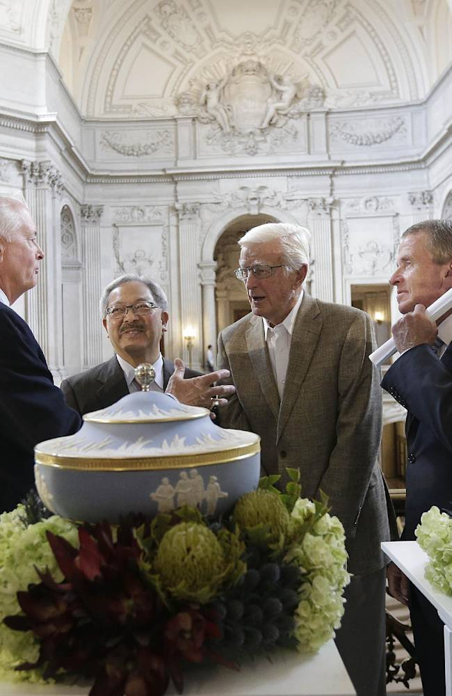 PGA of America President Ted Bishop, from left, talks with San Francisco Mayor Ed Lee, Sandy Tatum, former president of the United States Golf Association, and PGA Tour Commissioner Tim Finchem after a news conference announcing that TPC Harding Park will host the U.S. PGA Championship in 2020 and the Presidents Cup in 2025 at City Hall in San Francisco, Wednesday, July 2, 2014. TPC Harding Park will also host the Match Play Championship in 2015