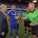 Referee Robert Sibiga shows the coin for the coin toss to Tadanobu Nagumo, Chairman and CEO, The Yokohama Rubber Company as Chelsea defender Branislav Ivanovic looks on prior to taking on the New York Red Bulls seen at the International Champions Cup, on