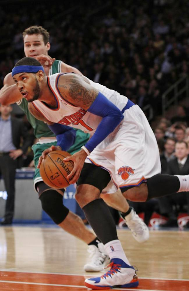 New York Knicks forward Carmelo Anthony (7) moves the ball into the paint as Boston Celtics center Kris Humphries defends in the second half of an NBA basketball game at Madison Square Garden in New York, Tuesday, Jan. 28, 2014. Anthony had 24 points as the Knicks defeated the Celtics 114-88
