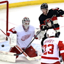 Detroit Red Wings goaltender Jonas Gustavsson (50) keeps his eyes on the puck has teammate Brian Lashoff(23) and Ottawa Senators' Kyle Turris (7) watch for a rebound during third period NHL hockey action in Ottawa ,Thursday, Feb. 27, 2014. Detroit beat Ot