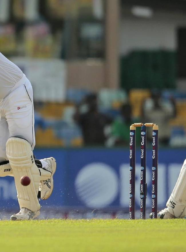 Sri Lankan cricketer Angelo Mathews bats as Pakistani wicketkeeper Sarfraz Ahmed watches during the first day of the second test cricket match between Sri Lanka and Pakistan in Colombo, Sri Lanka, Thursday, Aug. 14, 2014