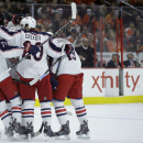 Columbus Blue Jackets Nick Foligno (71), Time Erixon(20) and Ruan Johansen (19) celebrate with team maters after a goal by James Wisniewski during the first period of an NHL hockey game against the Philadelphia Flyers, Friday, Nov. 14, 2014, in Philad