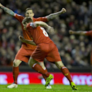 Liverpool's Steven Gerrard, lower centre, celebrates with teammate Daniel Agger after scoring against Sunderland during their English Premier League soccer match at Anfield Stadium, Liverpool, England, Wednesday March 26, 2014