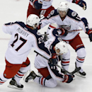 Columbus Blue Jackets' Matt Calvert (11) goes to his knees to celebrate his game-winning goal with teammates Ryan Murray (27), and Cam Atkinson (13) in the second overtime period of a first-round NHL playoff hockey game in Pittsburgh, Saturday, April 19,