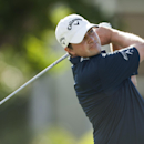 Brian Stuard follows his drive off the first tee during the second round of the Sony Open golf tournament, Friday, Jan. 10, 2014, in Honolulu. (AP Photo/Marco Garcia)