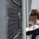 Driver Brad Keselowski waits along the pit road fence before practice for the Brickyard 400 Sprint Cup series auto race at the Indianapolis Motor Speedway in Indianapolis, Friday, July 25, 2014. (AP Photo/AJ Mast)