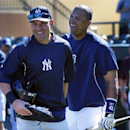 New York Yankees' Jacoby Ellsbury, left, is greeted by Detroit Tigers' Victor Martinez as he arrives for an exhibition spring training baseball game in Lakeland, Fla., Friday, Feb. 28, 2014 The Associated Press