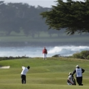 Andres Romero of Argentina hits from the fairway to the 13th green of the Monterey Peninsula Country Club Shore Course during the second round of the AT&T Pebble Beach Pro-Am golf tournament  Friday, Feb. 8, 2013 in Pebble Beach, Calif. (AP Photo/Eric Risberg)