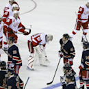 Detroit Red Wings' Jonas Gustavsson (50), of Sweden, leaves the ice with teammates after the overtime period of an NHL hockey game against the New York Rangers Wednesday, Nov. 5, 2014, in New York. The Rangers won the game 4-3 The Associated Press