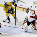 Nashville Predators center Craig Smith (15) scores against Ottawa Senators goalie Craig Anderson (41) in the third period of an NHL hockey game Thursday, Oct. 9, 2014, in Nashville, Tenn The Associated Press