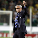 Chelsea's head coach Jose Mourinho celebrates his side's 1-0 win at the end of a Champions League, Group G soccer match between Sporting and Chelsea, in Lisbon, Tuesday, Sept. 30, 2014